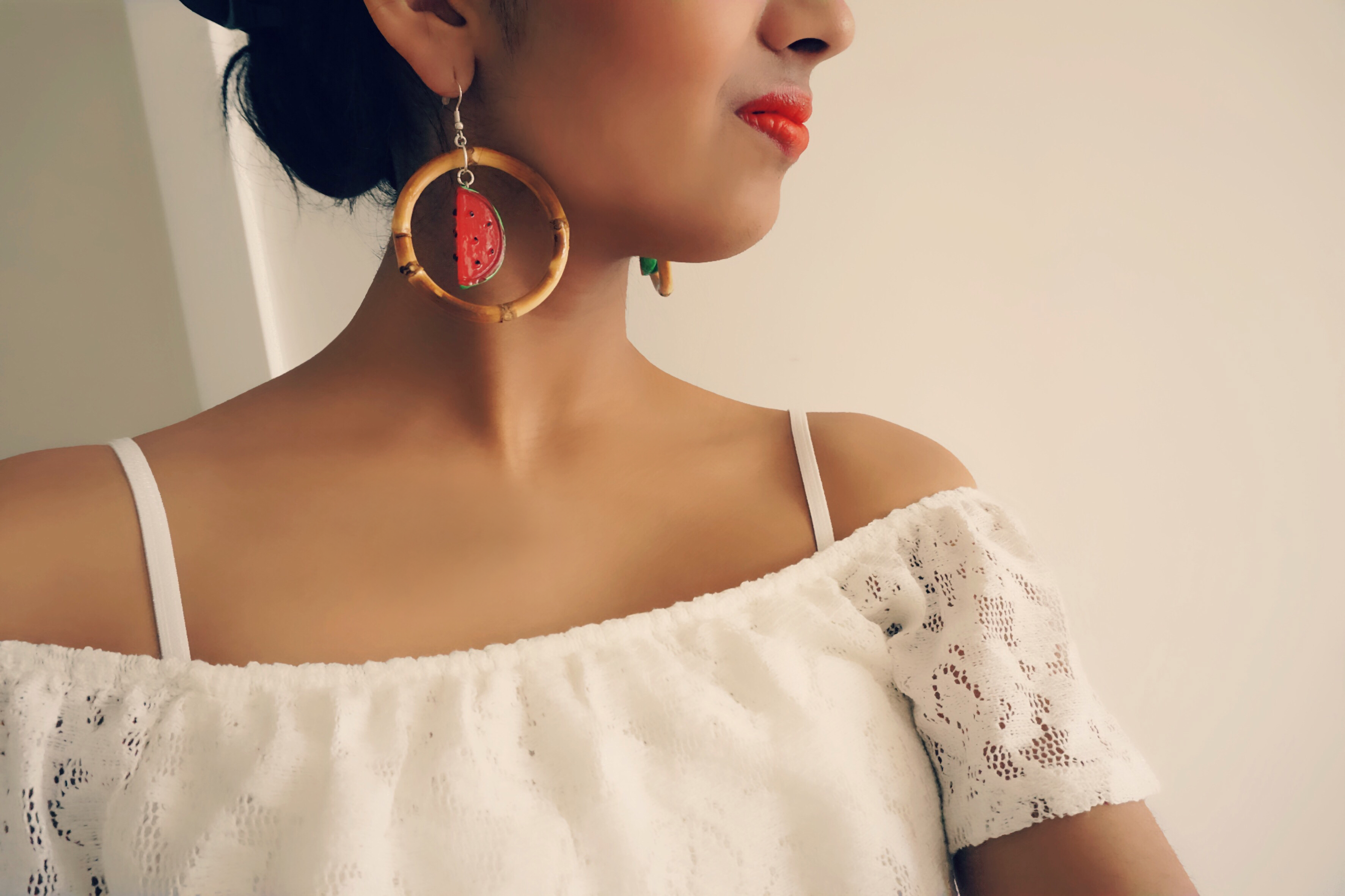 Bow and Crossbones earrings and lace top