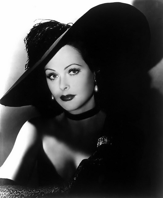 Glamorous Hedy Lamour with lace gloves and black hat
